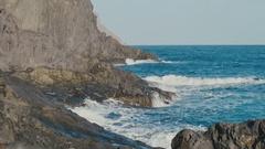 Ocean, blue water waves crashing on volcanic rocks Stock Footage