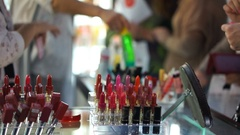 Beauty consultants selling products to customers, giving advice on cosmetics Stock Footage