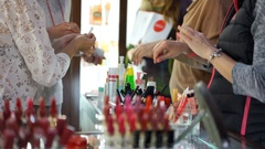 Female customers testing new beauty products in department store, cosmetology Stock Footage