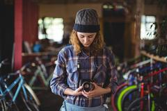 Woman adjusting vintage camera Stock Photos