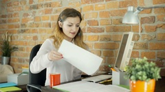 Call center agent cleaning her desk in the office and smiling to the camera Stock Footage