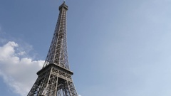 Symbol of France and Paris Eiffel tower against blue sky slow pan 4K 2160p 30 Stock Footage