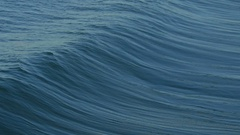 A powerful wave crashes at the beach and turns into whitewash, slow motion. Stock Footage
