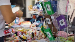 Japanese greeting cards on stall, souvenir shop, customer choosing a present Stock Footage