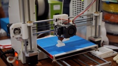 3D printing in progress, affordable manufacturing, printer making an object Stock Footage