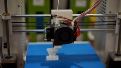 3D printer mechanism close-up, ink jets creating an object, mass manufacturing Stock Footage