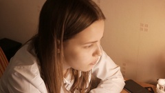 Teenage girl studying with unhappy face. 4K UHD Stock Footage