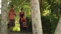 Slow Motion Family Father Mother Daughter Baby In Park Stock Footage