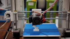 3D printer printing a figurine, additive manufacturing in progress, workshop Stock Footage