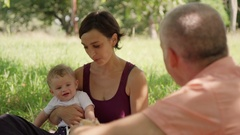 Mom Dad And Son Laughing And Eating Food During Picnic Stock Footage