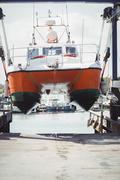 Boat on a hydro hoist boatlift Stock Photos