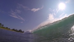 An empty tube wave POV as the lip curls, slow motion. Stock Footage