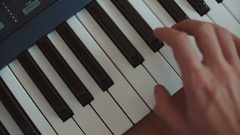 Playing hand man piano synthesizer hand run over keys Stock Footage