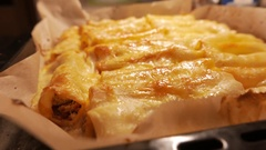 Baked cannelloni stuffed with vegetable mix. 4K UHD Stock Footage