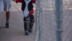Details of a boy playing catcher for a little league baseball team, slow motion. Stock Footage