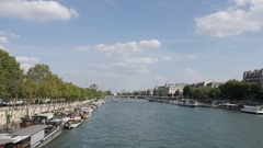 PARIS, FRANCE - AUGUST 2016 Under blue sky river Seine flow and yachts Stock Footage