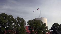 Latvian flag and Latvian presidential Standard of Riga castle tower Stock Footage
