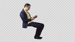 Male in denim jacket is sitting, looking at smartphone. Transparent background Stock Footage