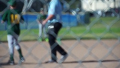 A boy runs home to score a home run while playing little league baseball, slow m Stock Footage