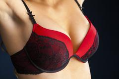 Woman breast in uplift Stock Photos