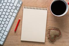 Blank notepad on wooden table Stock Photos