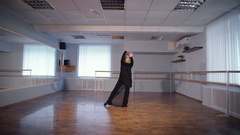 Housewife doing her favorite hobby. Adult woman is dancing a new dance in a Stock Footage
