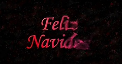 "Merry Christmas text in Spanish ""Feliz Navidad"" formed from dust and turns to Stock Footage"