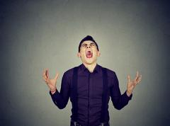 Frustrated desperate young man screaming Stock Photos
