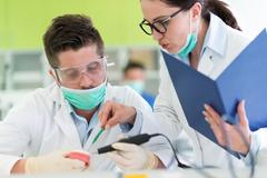 Busy young stomatology students working carefully on anatomical models Stock Photos