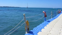 Floating pier near the sea, yachting, sailing, summer outdoor activities Stock Footage