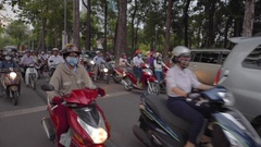 People drive by motorcycles in district one Stock Footage