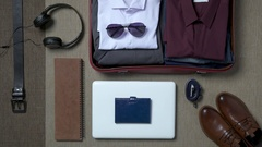 Getting ready for a trip and packing a suitcase Arkistovideo