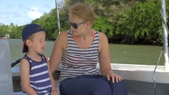 Mother and son having nature boat travel Stock Footage