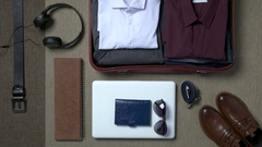 Businessman packing a suitcase Arkistovideo