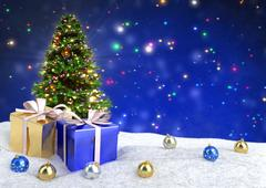 Christmas tree and gifts in snow on bokeh blue background. 3D illustration Stock Illustration