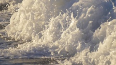 Detail of the whitewash as waves break in the surf, slow motion. Stock Footage