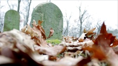 Lonely Gravestone in dreary creepy cemetery Version 2 Stock Footage