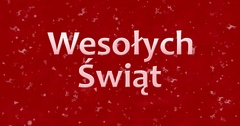 "Merry Christmas text in Polish ""Wesolych Swiat"" turns to dust from bottom on red Stock Footage"