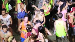 Girls and guys dancing the beach during Full Moon party . Koh Phangan, Thailand Stock Footage