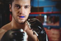 Boxer performing a boxing stance Stock Photos