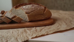 Sliced bread on wooden board. Slices of homemade bread on cutting board Stock Footage