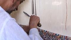 Carpet weaving . Man weaves a carpet Kashmir at weaving factory. Srinagar, India Stock Footage