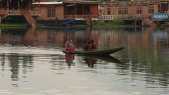 People use small boat for transportation in the lake of Srinagar , India Stock Footage