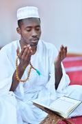 African Muslim Man Praying To God Stock Photos