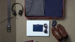 Businessman packing a suitcase for a trip Arkistovideo
