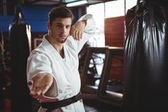 Karate player performing karate stance Stock Photos