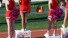 Cheerleaders at a football game. Stock Footage