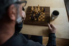 Attentive man playing chess Stock Photos