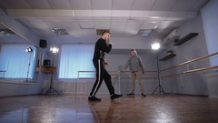 Two young hip hop dancer in the hall for rehearsals. They train. Look at how Stock Footage