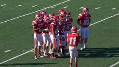 A football team huddles, slow motion. Stock Footage